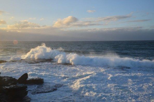 Clovelly sun on waves
